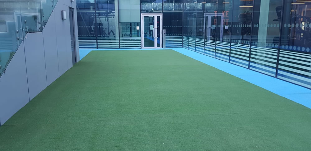Artificial grass for indoor spaces